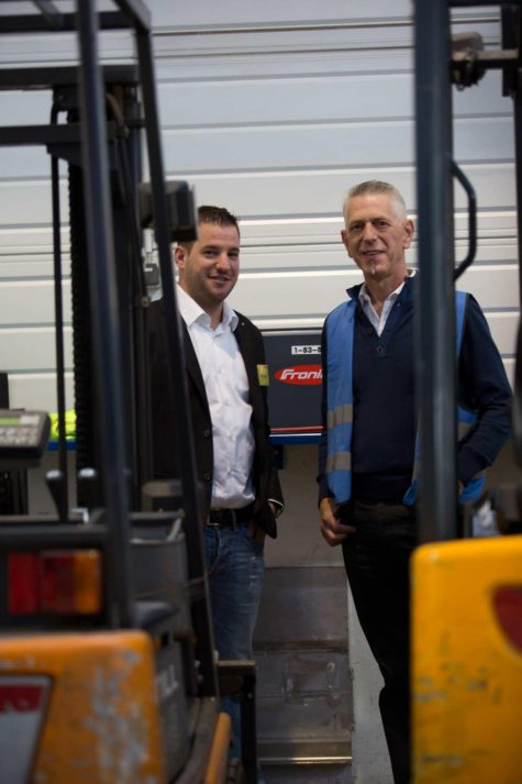"""With technology from Fronius, we were able to dramatically reduce the energy consumption of our forklift truck fleet."" Silvio Kellenberger (right), head of the warehousing department at Rhenus Contract Logistics, and Reto Baumgartner, Sales Advisor for Battery Charging Systems at Fronius Switzerland."